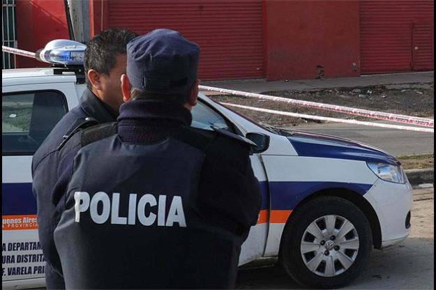 policia-en-patrullero1
