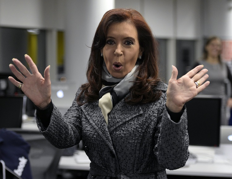 Argentine President Cristina Fernandez de Kirchner gestures during a tour of the new Facebook Argentina headquarters, in Buenos Aires on May 6, 2014. Fernandez de Kirchner attended the inauguration of the Facebook headquarters in Buenos Aires. AFP PHOTO / JUAN MABROMATA